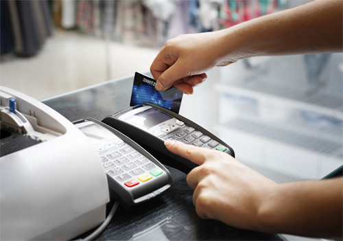Use debit card for withdrawals and credit card for purchases